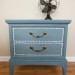 Blue nightstand with a little design