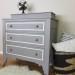 A plum-grey dresser with modern lines