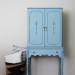 A long-legged light blue cabinet