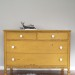 A chippy, mustard yellow dresser
