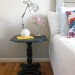 A navy pedestal side table