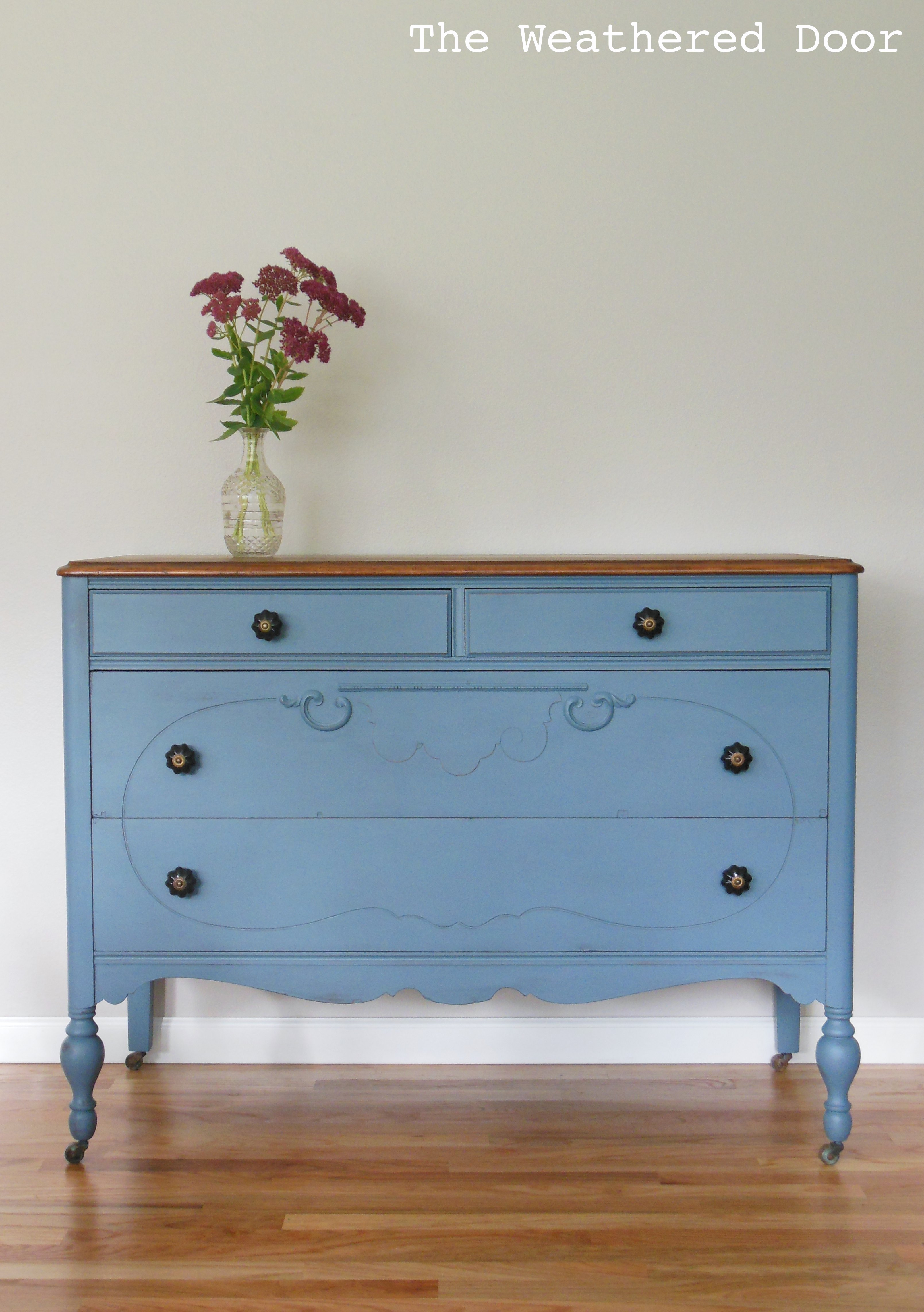 A Smokey Blue Dresser With Stained