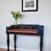 A Black and Salmon Spinet Desk