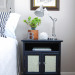A Navy Nightstand with Papered Doors
