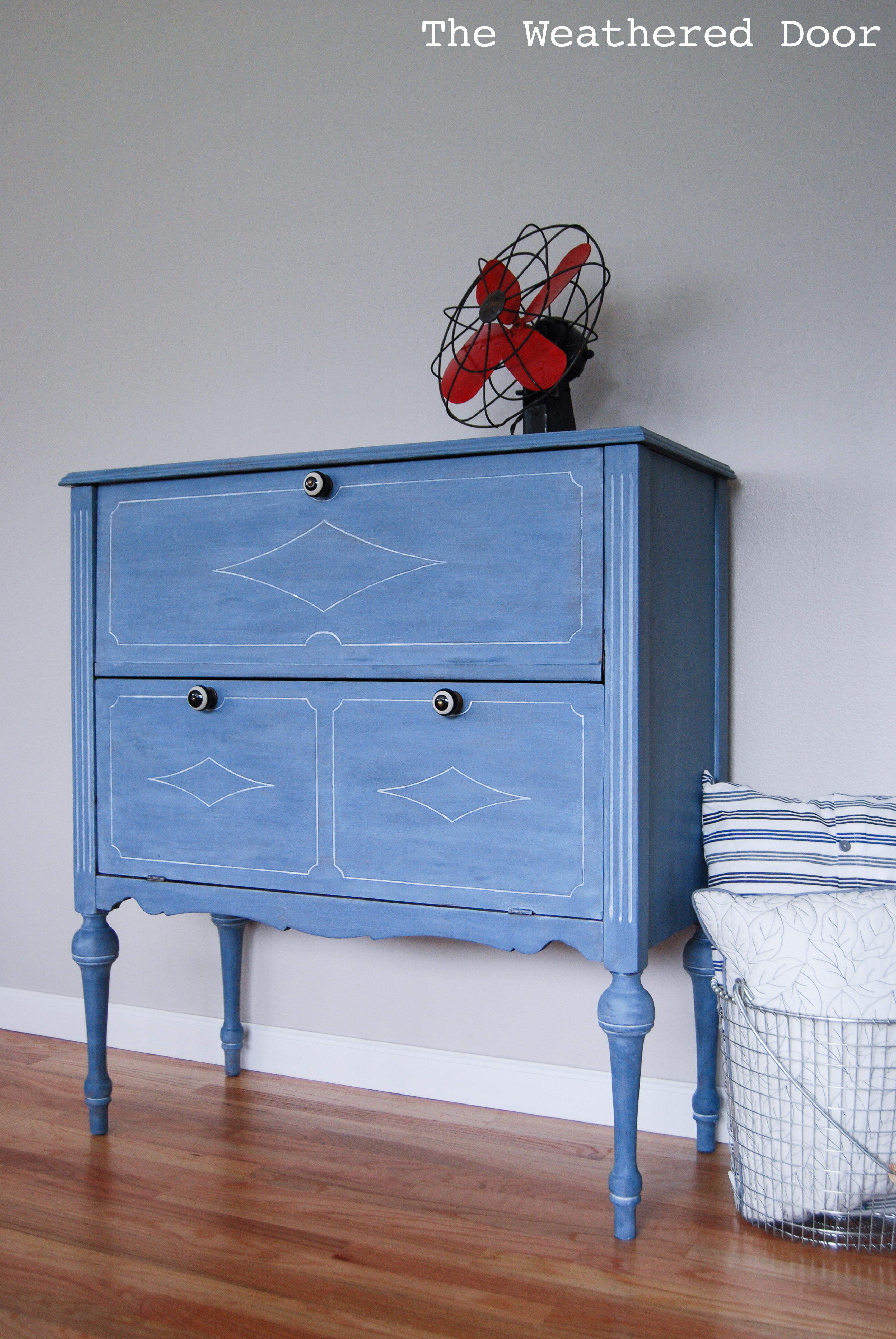A Soldier Blue Milk Paint Cabinet With A White Wax Finish