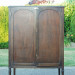 An Antique Cabinet and a Survey